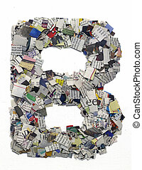Letters made from newspaper capitel B