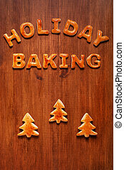 Letters of dough and Christmas cookies on the wooden table