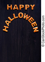 Letters of dough on the wooden table. Halloween background