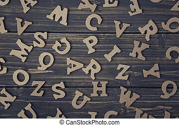 Letters on a wooden background