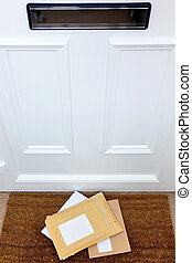 Letters on the doormat - Letters and a package lying on a ...