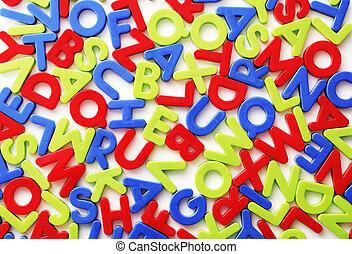 Letters - Plastic colorful random letters on white...