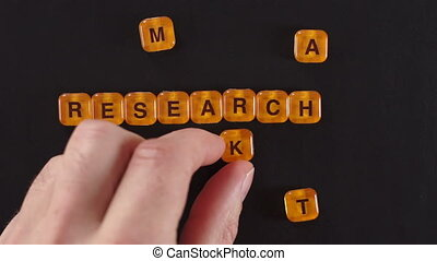 Letters Spell Market Research - A close up shot of a man...
