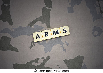 letters with text arms on the khaki background. military concept