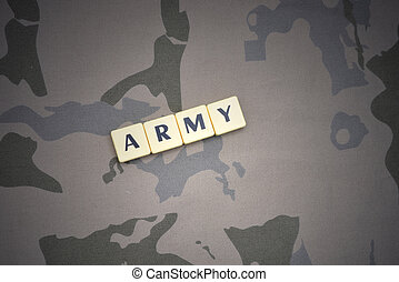 letters with text army on the khaki background. military concept