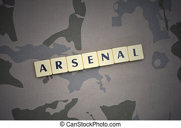 letters with text arsenal on the khaki background. military concept