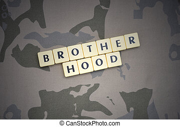 letters with text brotherhood on the khaki background. military concept