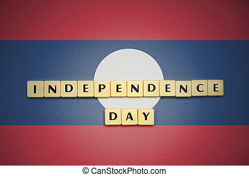 letters with text independence day on the national flag of laos.