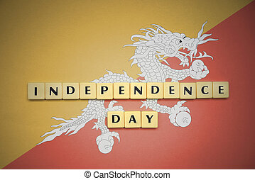 letters with text independence day on the national flag of bhutan.