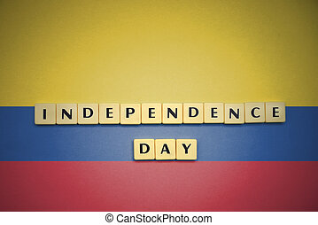 letters with text independence day on the national flag of colombia.