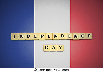 letters with text independence day on the national flag of france .