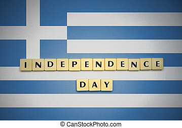 letters with text independence day on the national flag of greece.