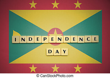 letters with text independence day on the national flag of grenada.