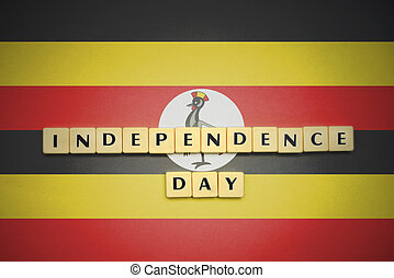 letters with text independence day on the national flag of uganda.