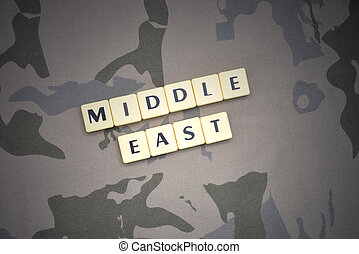 letters with text middle east on the khaki background. military concept
