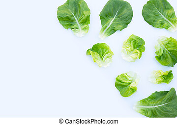 Lettuce leaves on white background. Top view