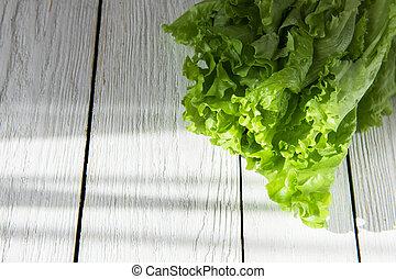 lettuce salad on a wood