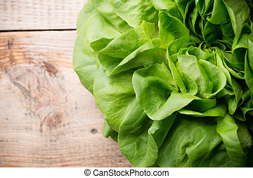 Lettuce.  - Salad on a wooden background. Studio picture.