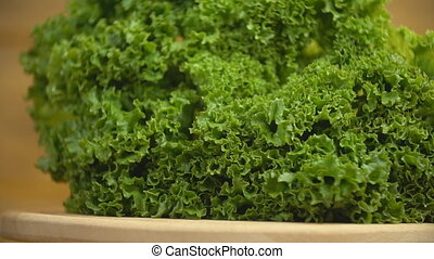 lettuce vegetable on a wooden tray that rotates
