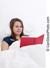 lettura donna, letto