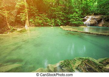 Level 1 of Erawan Waterfall with Neolissochilus stracheyi fish in Kanchanaburi Province, Thailand