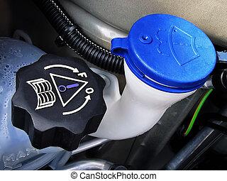 Level Caps - Several liquid caps inside a car engine