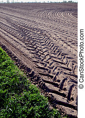 Leveled agricultural field truck wheel mark ground