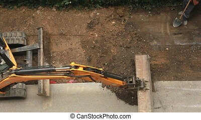 Leveling building site - Extracting and loading excavated...