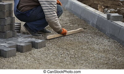 leveling gravel a wooden board