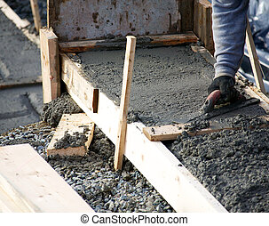 Levelling concrete footings - Concrete being levelled for...