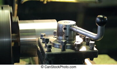 Lever locks the pressure on the surface on which the cutter lathe.