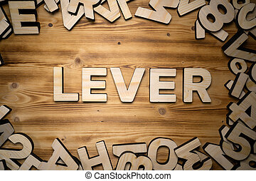 LEVER word made with block letters lying on wooden board