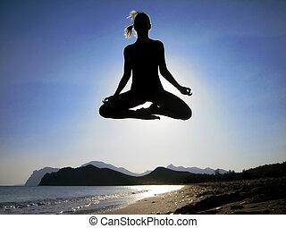 Levitation over the mounts - Female yogi flying over the...