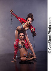 Lewdness. Two Flirty Woman in Erotic Pose Enjoying Music. Glamor