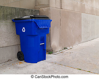 Lg Blue Trash Can on City Sidewalk - Large blue trash can...