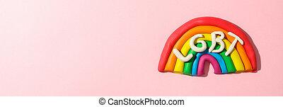 LGBT rainbow made of plasticine on pink background