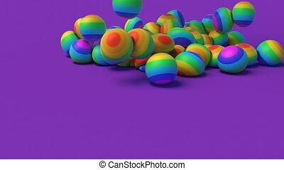 LGBT Rainbow rubber balls falling on a lilac surface minimalist cover footage 4k