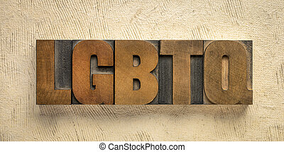 LGBTQ initialism in wood type blocks