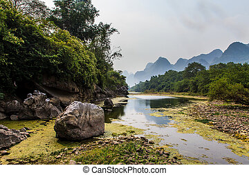 Li river with limestone formations in the background in ...