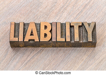 liability word abstract in wood type