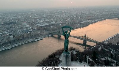 Liberty statue at sunrise, in Budapest, Hungary