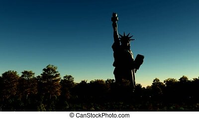Liberty statue at sunset to night sky
