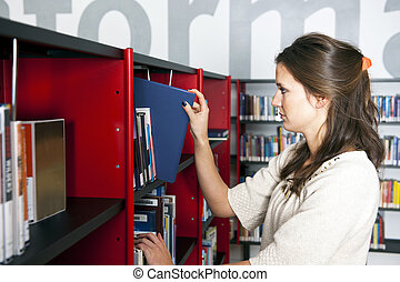 Librarian putting a book back in its place in the...