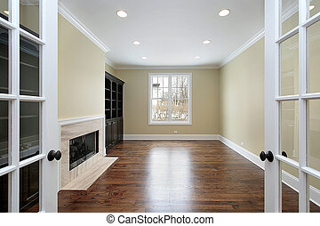 Library in new construction home with french doors
