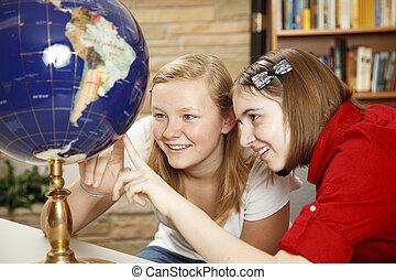 Library Teens Looking at Globe
