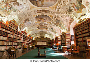 Library with ancient books, old globes, bookshelves, furniture in Theological Hall with stucco decoration Strahov monastery Czech Republic Prague