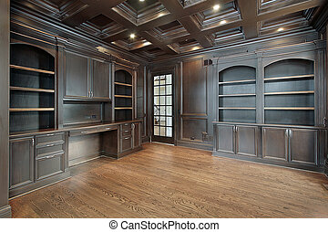 Library with dark paneling - Library in new construction...
