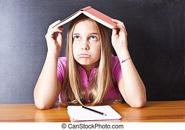 libro de la escuela, cabeza, niña, enfatizado
