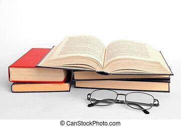 libros, anteojos