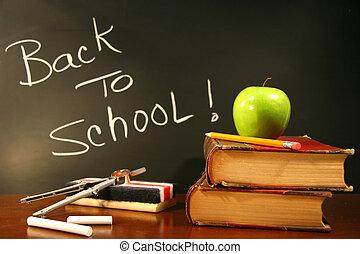 libros de la escuela, con, manzana, en el escritorio